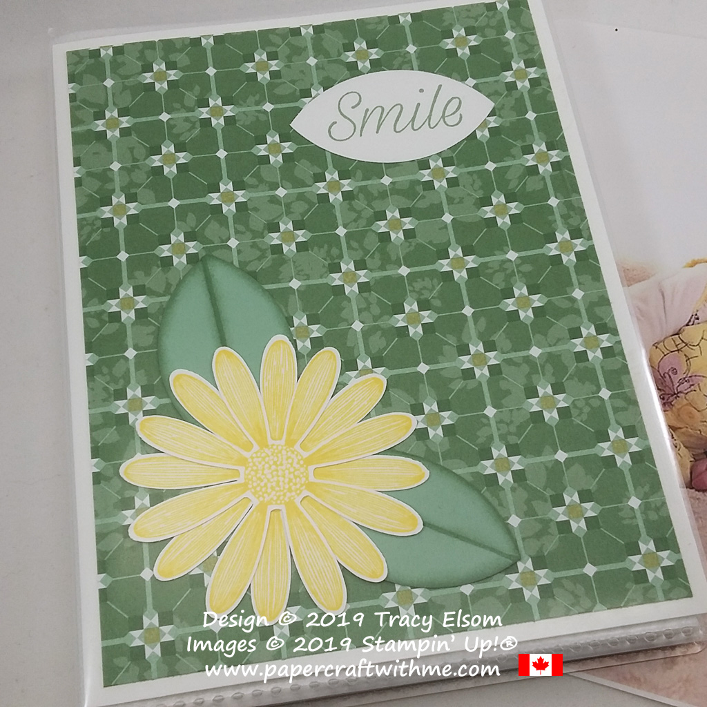 "Close up of 4"" x 6"" pocket photo album with large daisy image and ""smile"" sentiment from the Daisy Lane Stamp Set from Stampin' Up!"