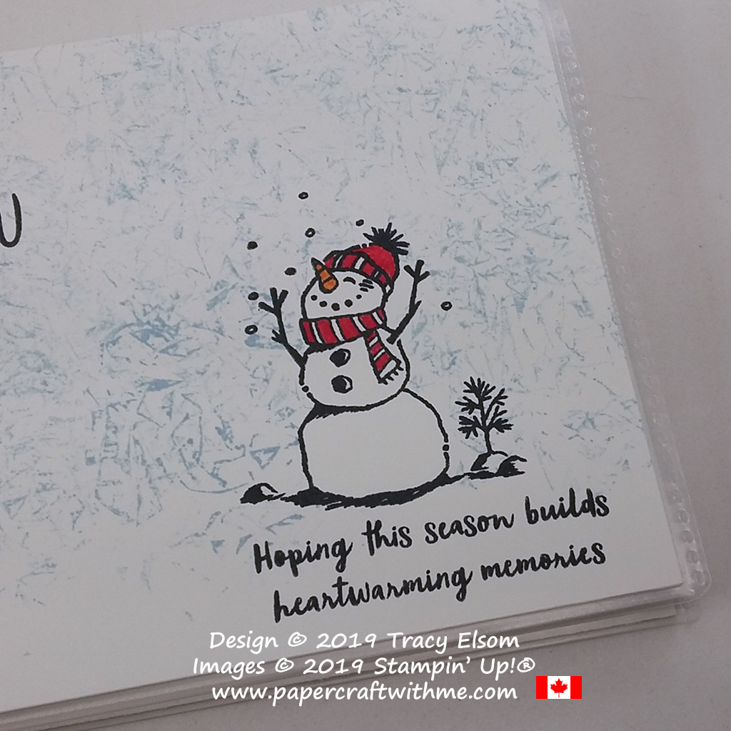 "Close up of 4"" x 6"" pocket photo album decorated using a Saran Wrap technique and the Snowman Season Stamp Set from Stampin' Up! #papercraftwithme"