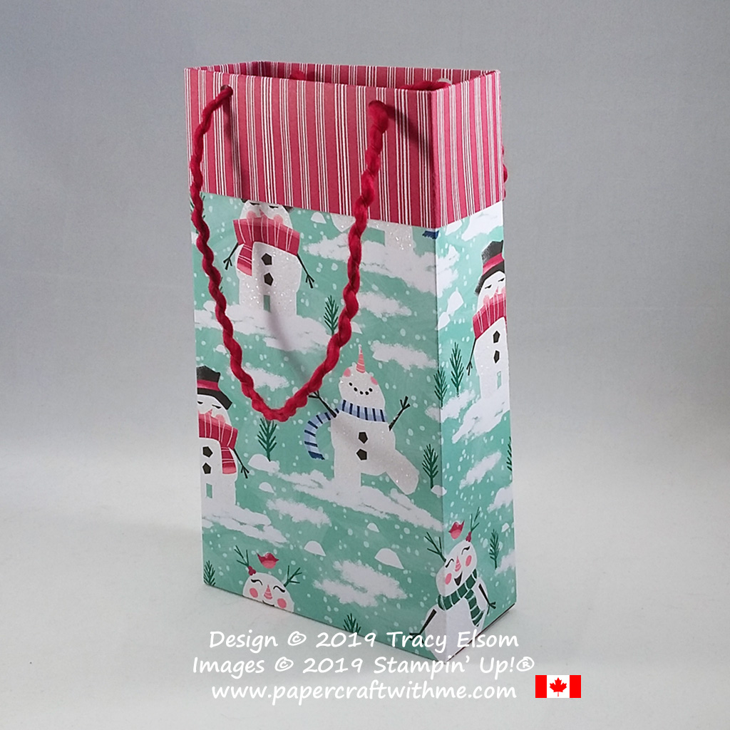 """Simple snowman covered 4"""" x 7"""" x 1-3/4"""" gift bag made using the Let It Snow DSP and Curly Ribbon from Stampin' Up! #papercraftwithme"""
