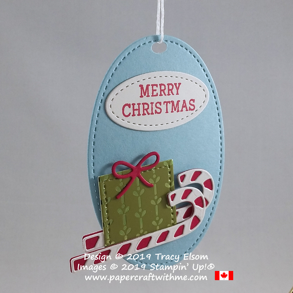 Large Santa's sleigh gift tag with candy canes for runners, created using the Cup of Christmas Stamp Set and coordinating Cup of Cheer Dies from Stampin' Up! #papercraftwithme