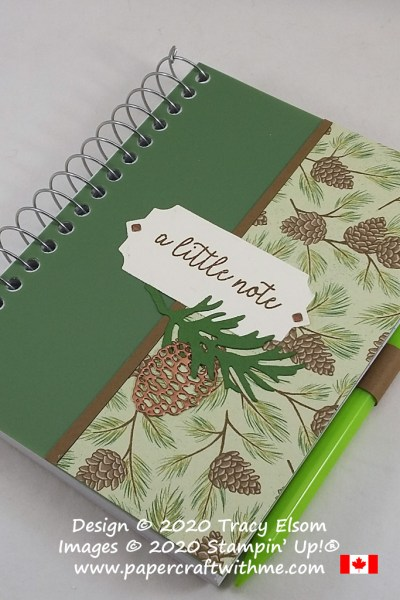 "I decorated this plain 3-1/2"" x 5"" spiral notebook with pine cone images using the Beautiful Boughs Dies and Poinsettia Place DSP paper from Stampin' Up! #papercraftwitme"