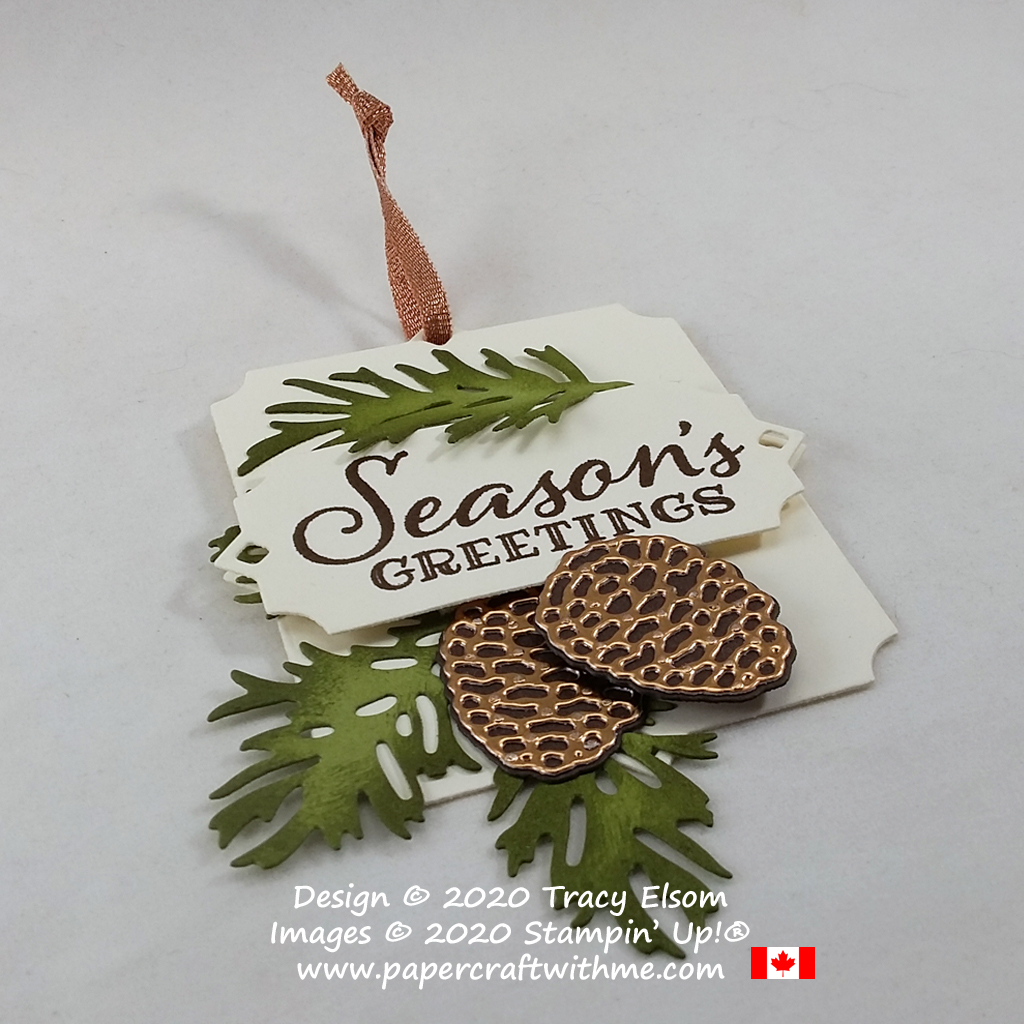 """Season's greetings"" with this gift tag decorated with pine cones using the Peaceful Boughs Stamp Set and coordinating Beautiful Boughs Dies from Stampin' Up! #papercraftwithme"