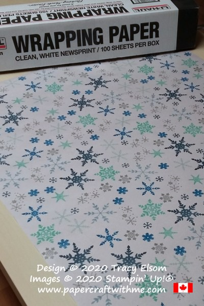 Hand-stamped gift wrapping paper using white newsprint paper and the Snowflake Wishes Stamp Set from Stampin' Up! #papercraftwithme