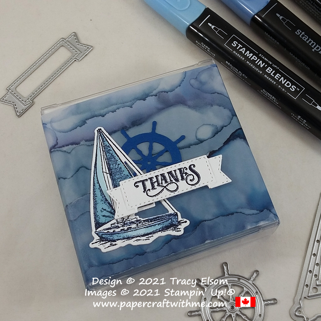 Alcohol ink technique used to create a watery background for this box sleeve, also using the Sailing Home Stamp Set and Smooth Sailing Dies from Stampin' Up! #papercraftwithme