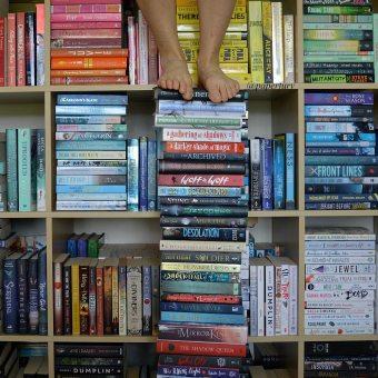 me + shelfie + feet tbr book stack
