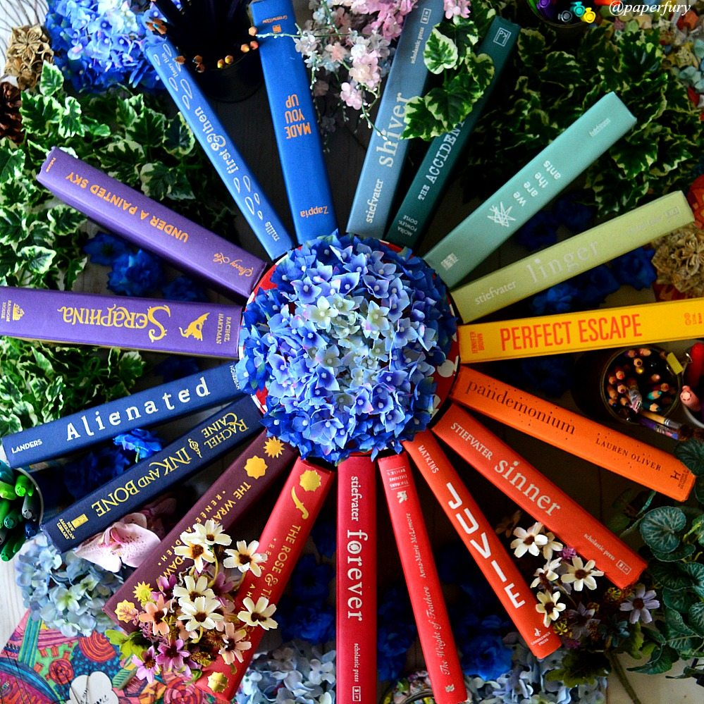 rainbow circle of books + flowerss