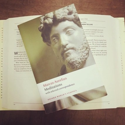 Meditations by Marcus Aurelius resting on a copy of The Daily Stoic by Ryan Holiday.