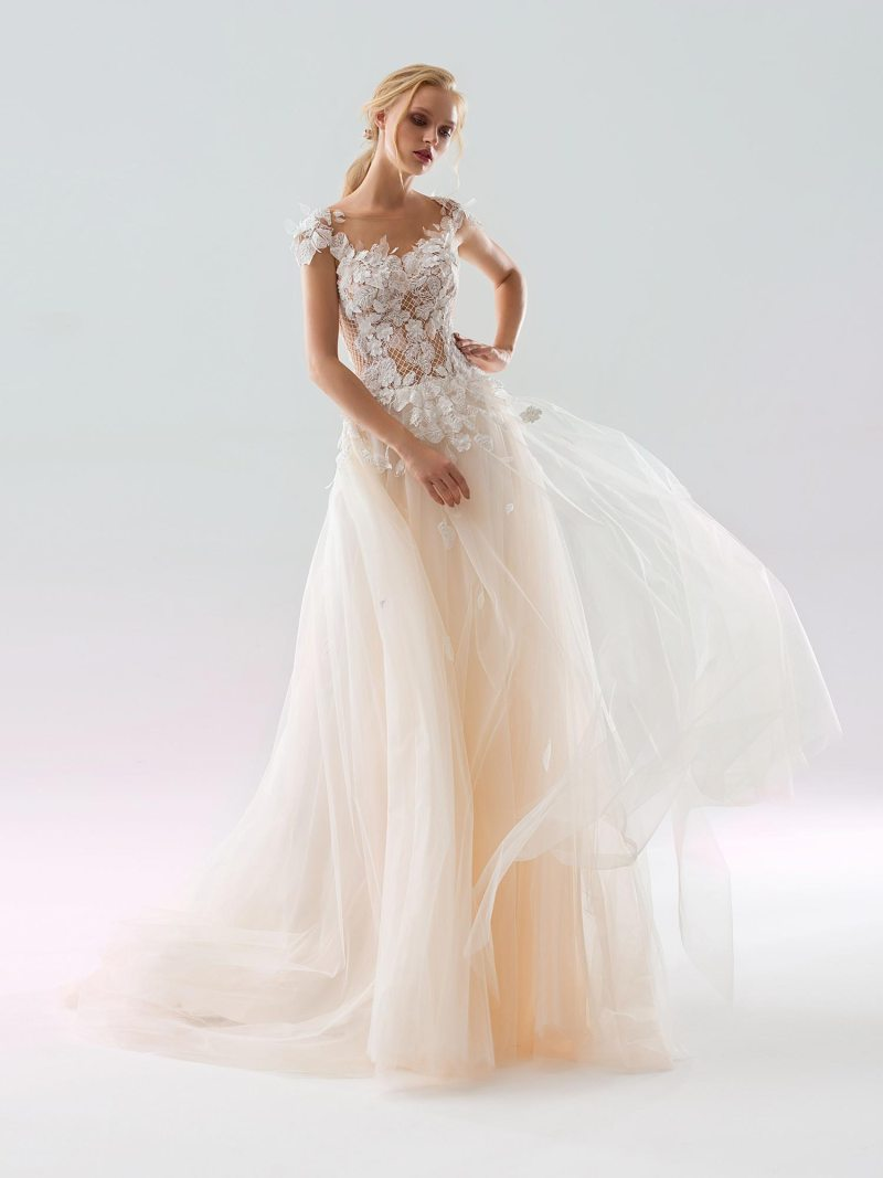 Ruffled A-line wedding dress with an illusion neckline and tiered skirt