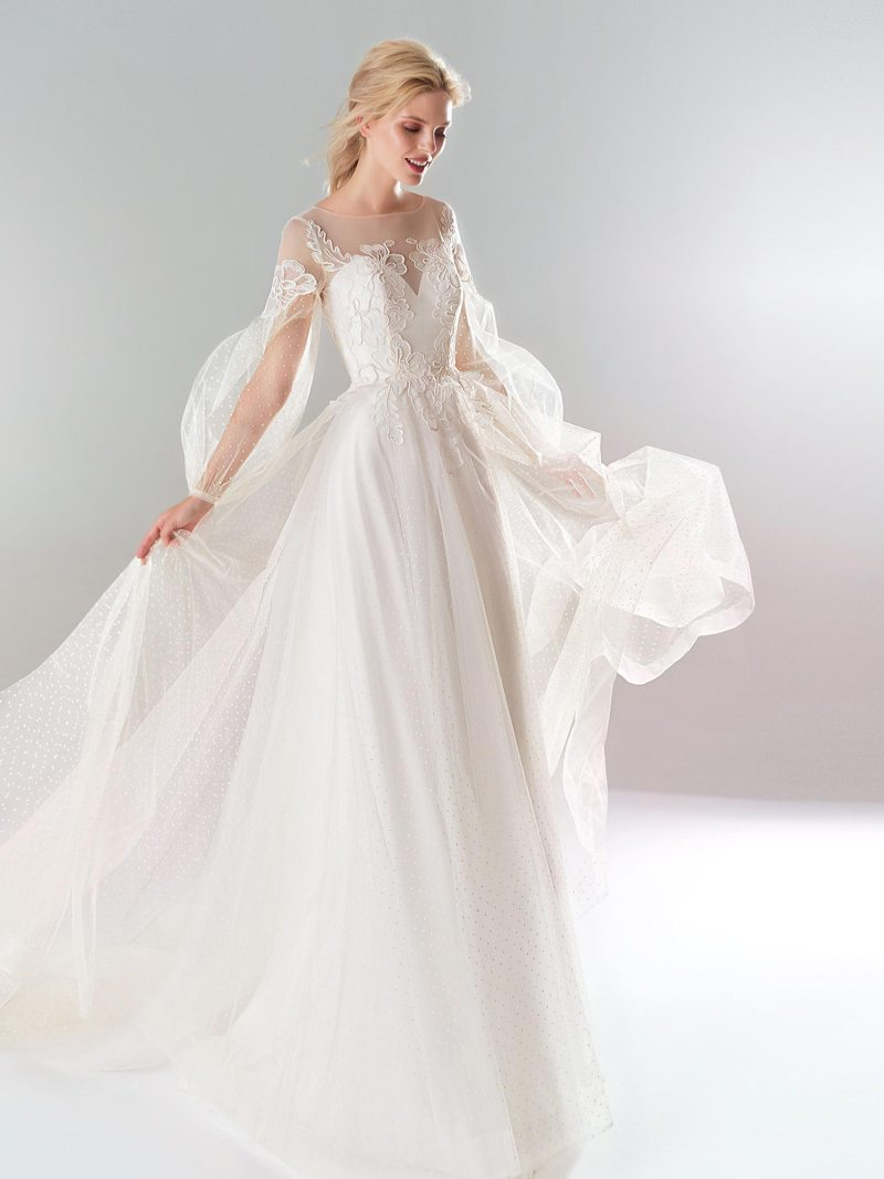 A-line wedding dress with polka dot lace and bishop sleeves