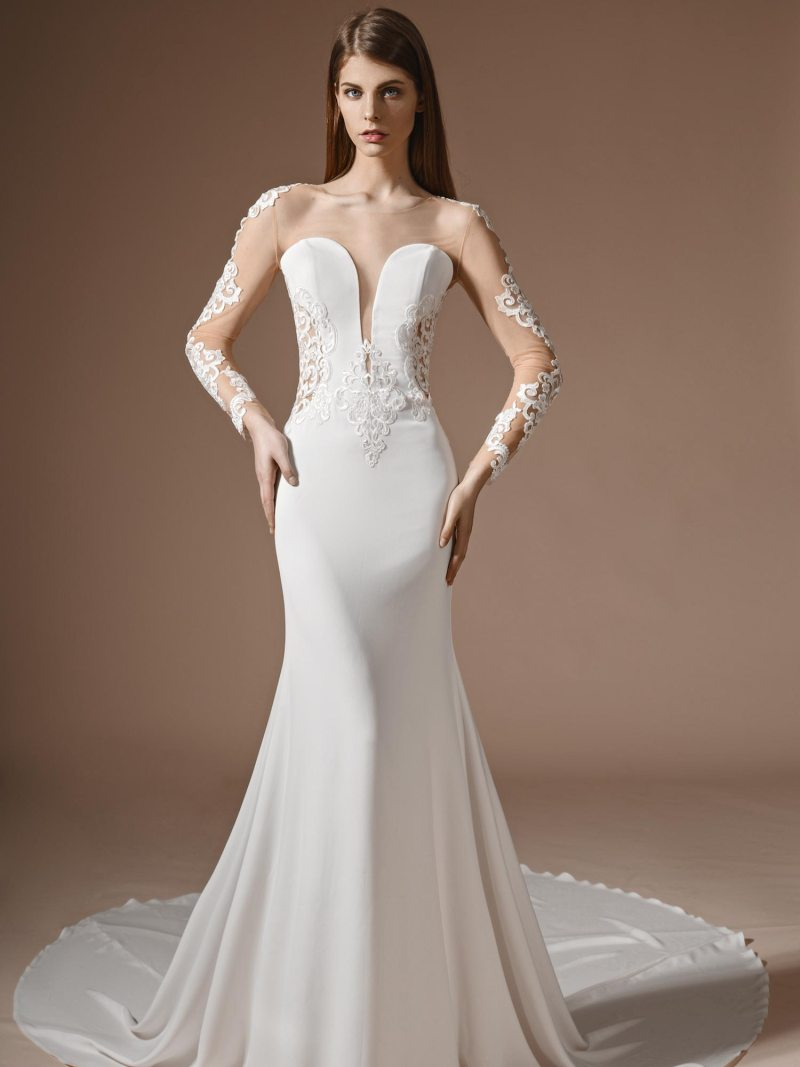 Fit and flare style wedding dress with illusion neckline and long sleeves