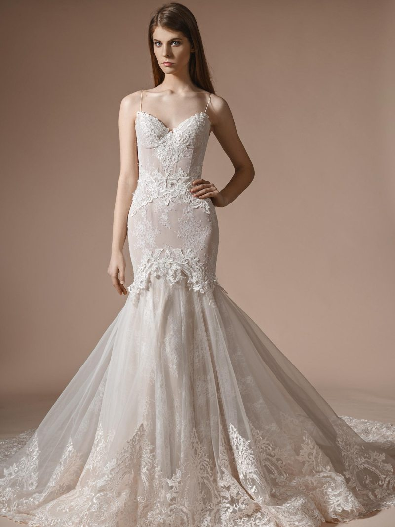 Fit and flare wedding gown with bustier bodice and lace detailing