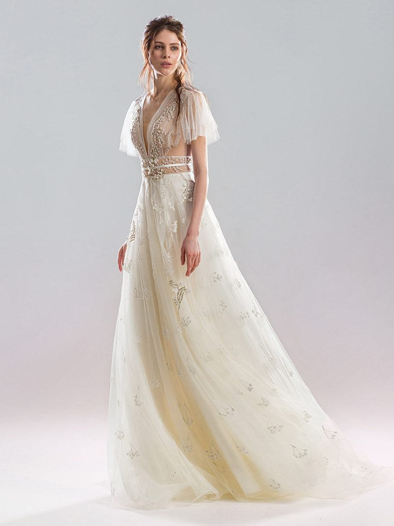 A-line wedding gown with flowing sleeves and beaded v neckline