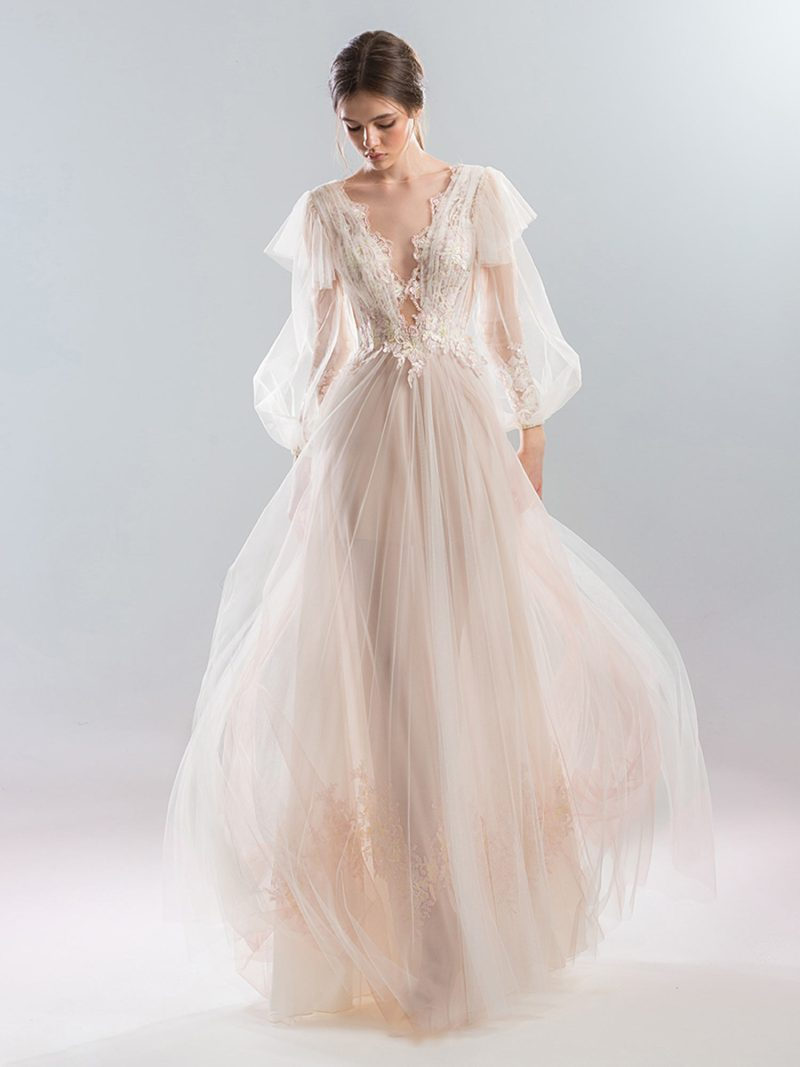 Deep v wedding dress with bishop sleeves and lace applique