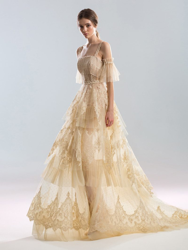 A-line wedding dress with tiered lace applique skirt and ruffled sleeves