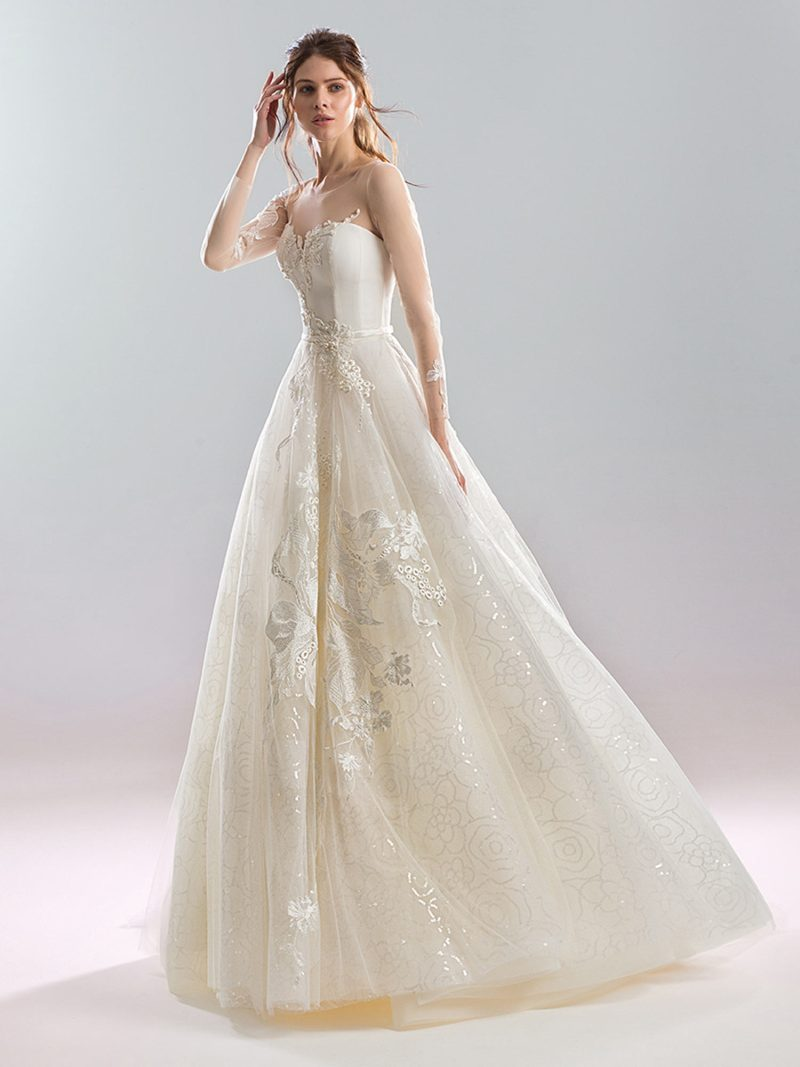 Soft ball gown wedding dress with illusion sleeves and metallic details