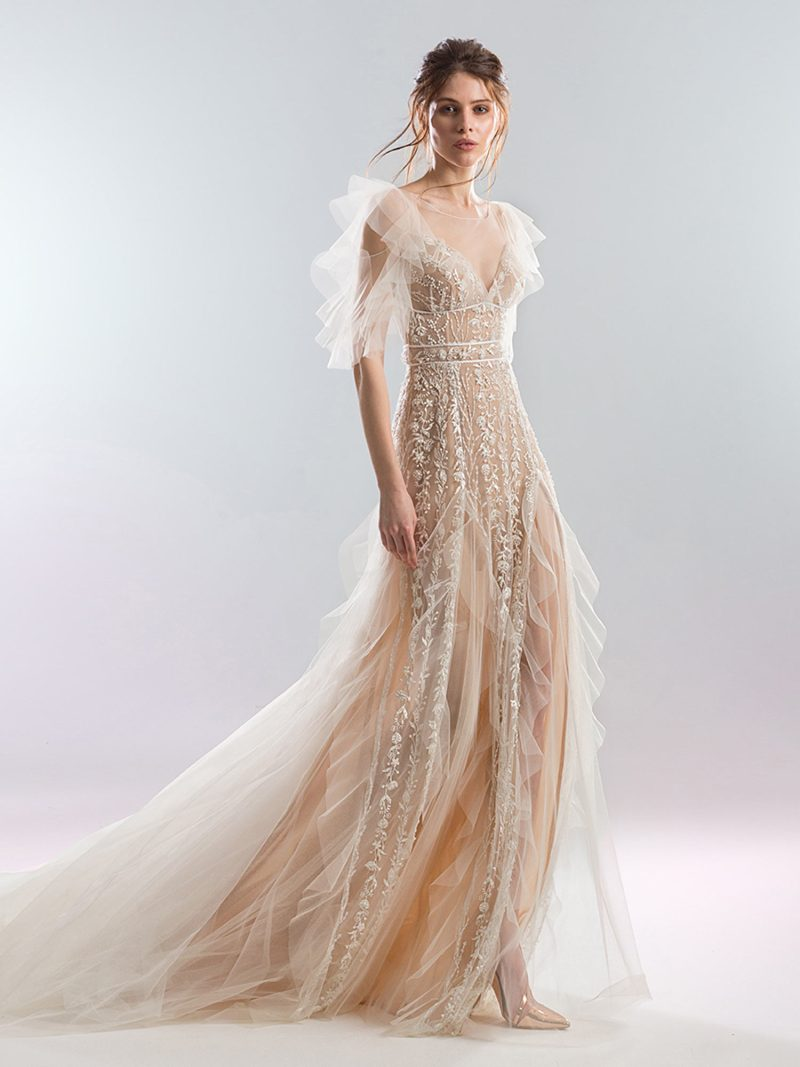 Ruffled sheath wedding dress with dramatic sleeves and floral beading