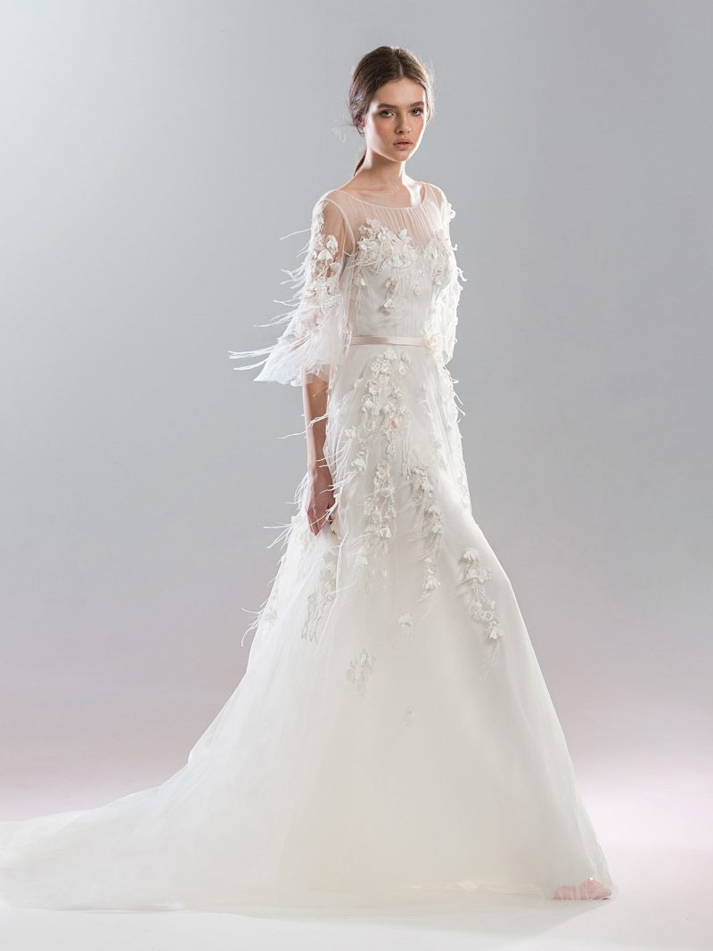 Floral A-line wedding gown with illusion neckline and bell sleeves