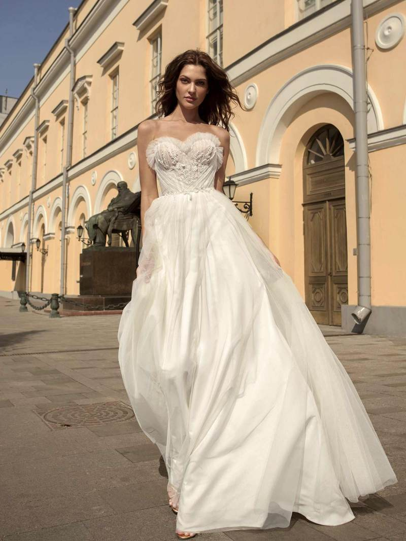 A-line strapless wedding gown with an intricated and detailed sweetheart bodice