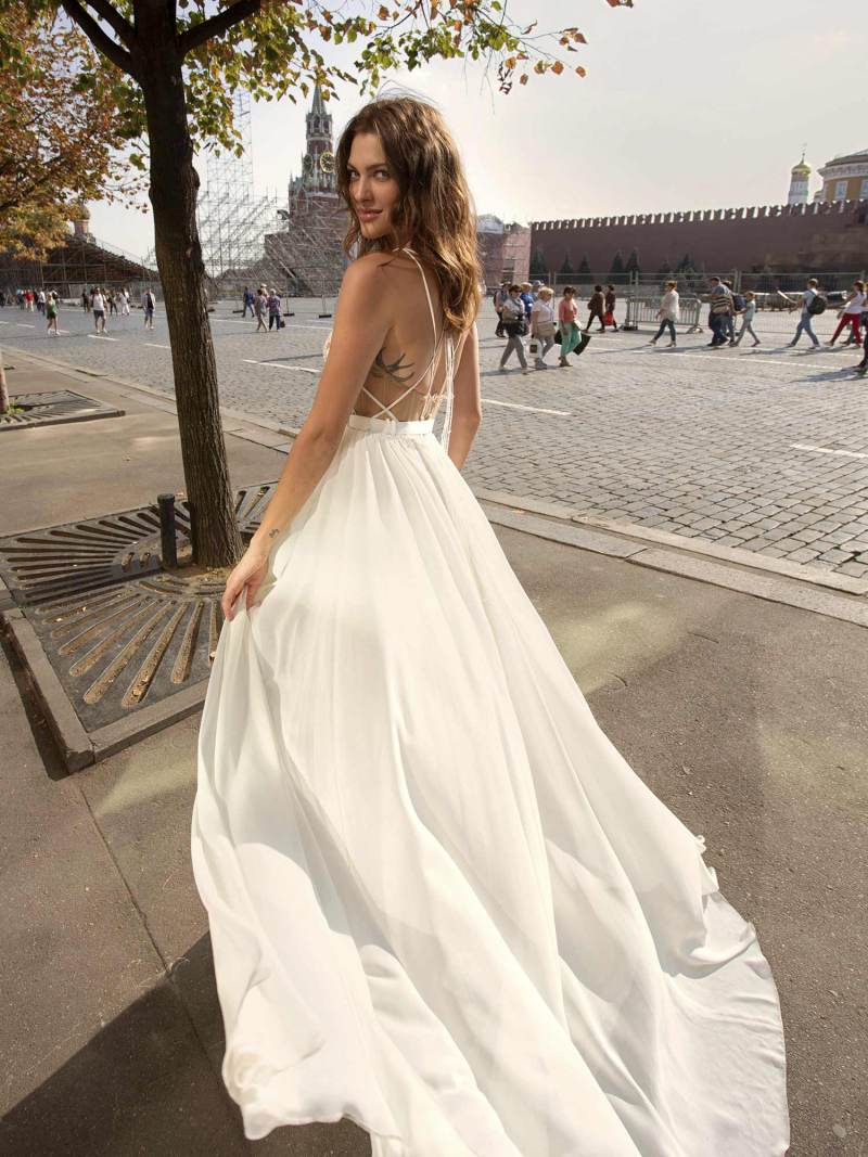 Wedding gown with a crisp chiffon skirt and pure lace bodice with plunging neckline and open back
