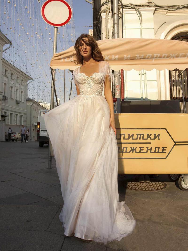 A-line wedding gown with butterfly sleeves and embroidered sweetheart bodice