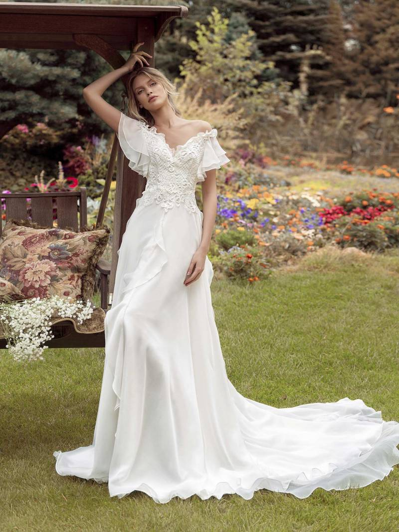 A-line wedding gown with off-the-shoulder sleeves