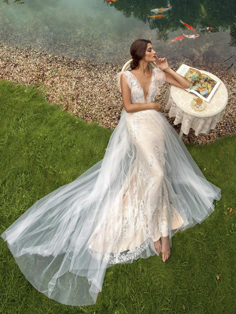 Fit and flare wedding gown with plunging neckline and overlay skirt