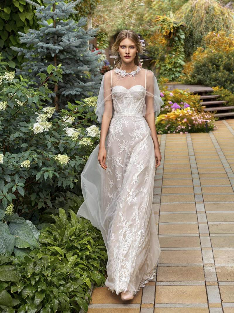 A-line wedding gown with bustier bodice and embellished tulle cape