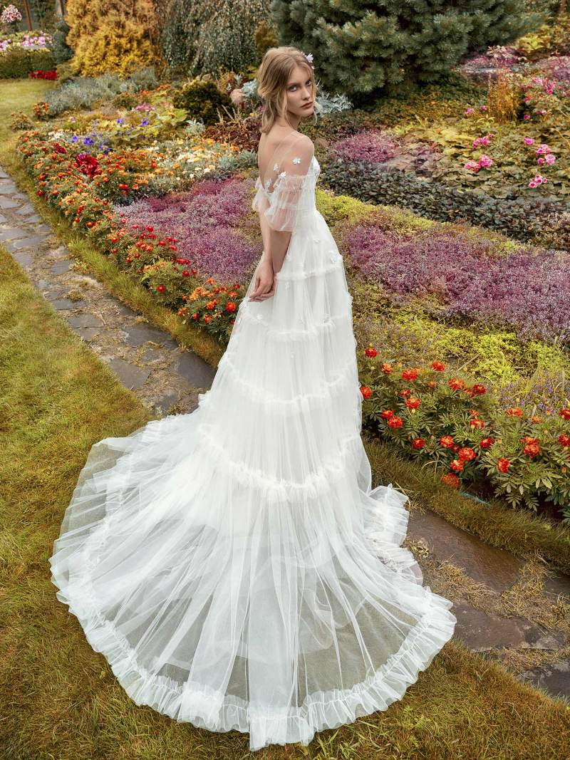 A-line wedding gown with ruffled sleeves and bustier bodice