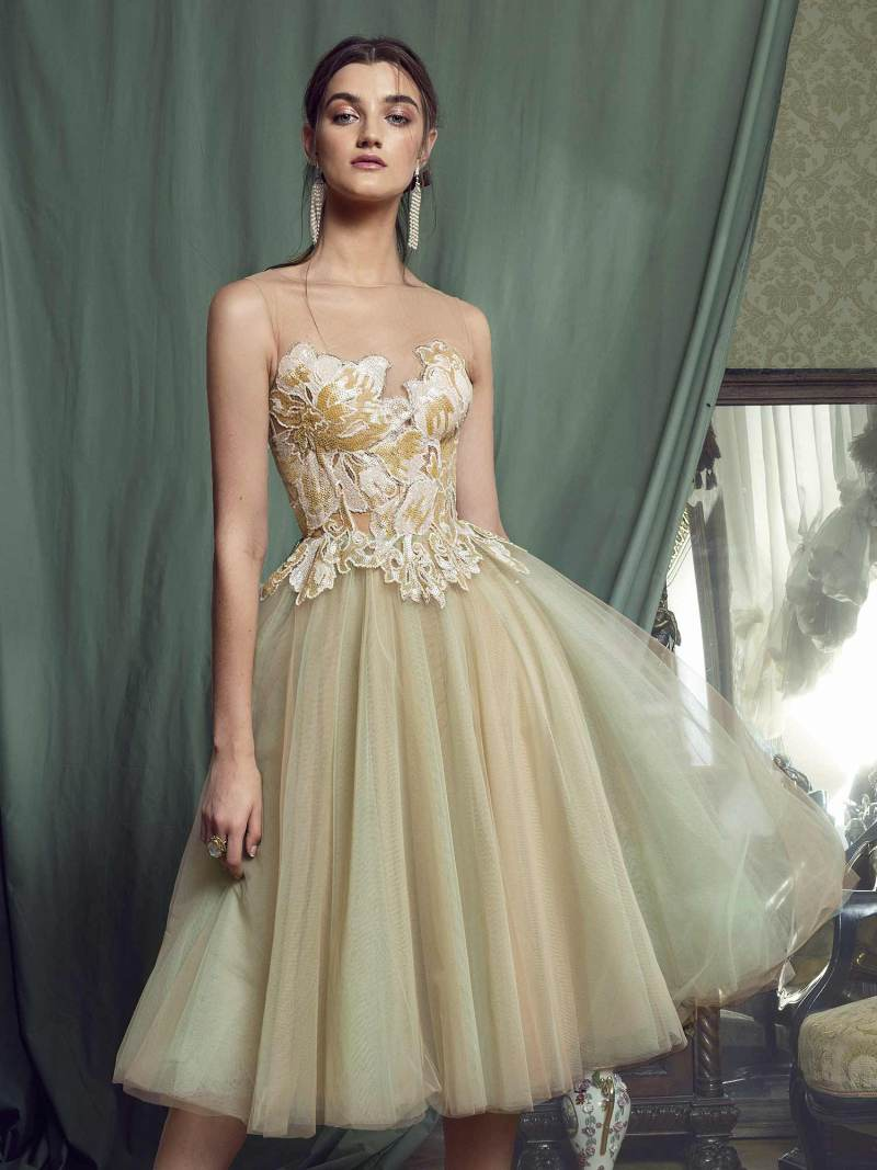 Ball gown evening dress with sequinned embroidered top