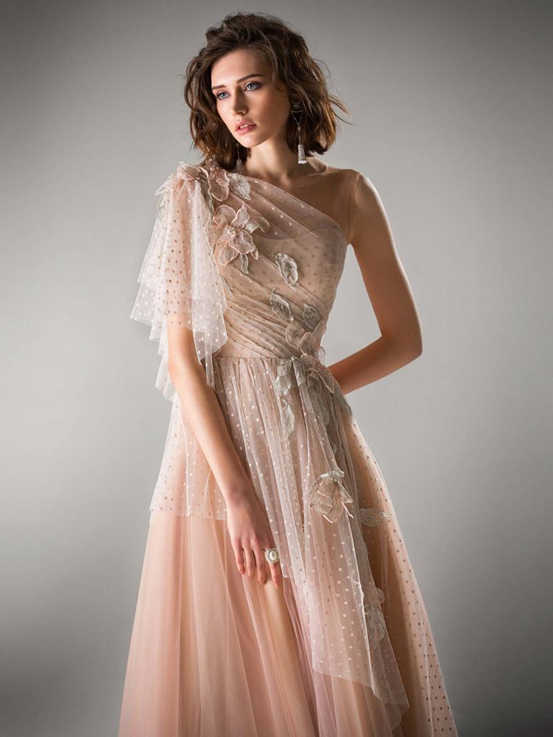 Tulle evening gown with one shoulder sleeve