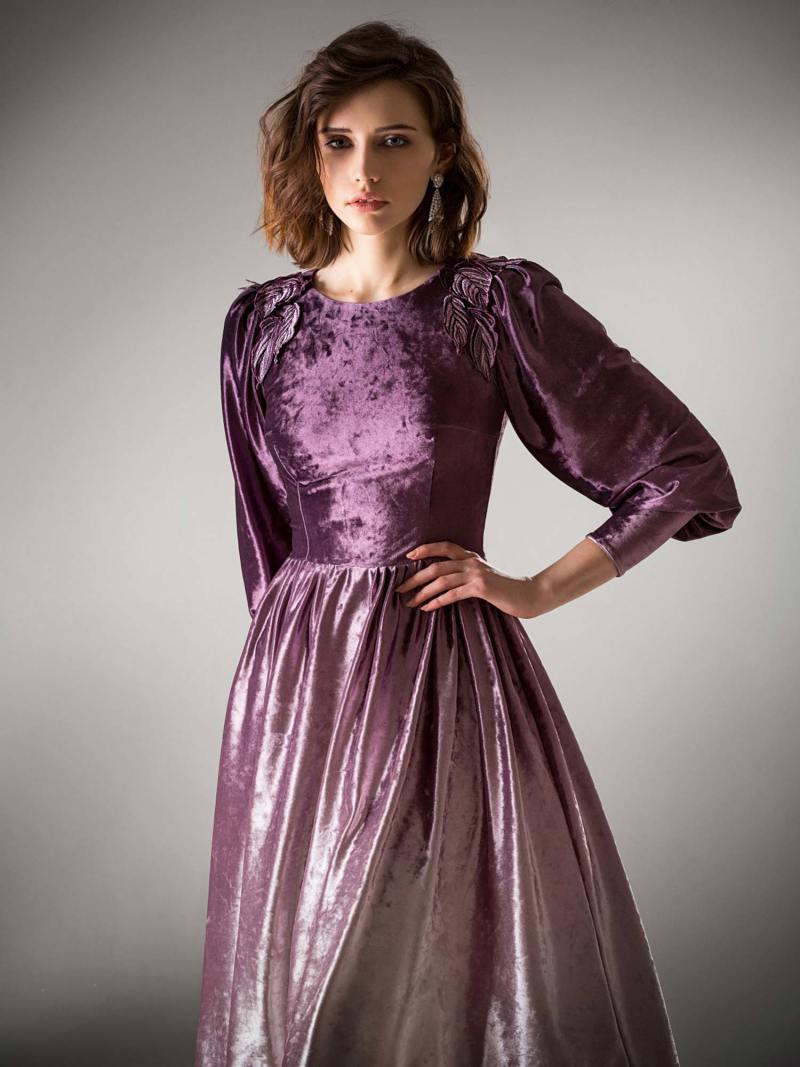 Velvet evening dress with dolman sleeves