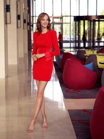 Cocktail dress with long sleeves and a peplum waist
