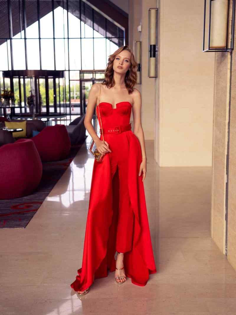Designer jumpsuit with strapless bodice and attachable skirt