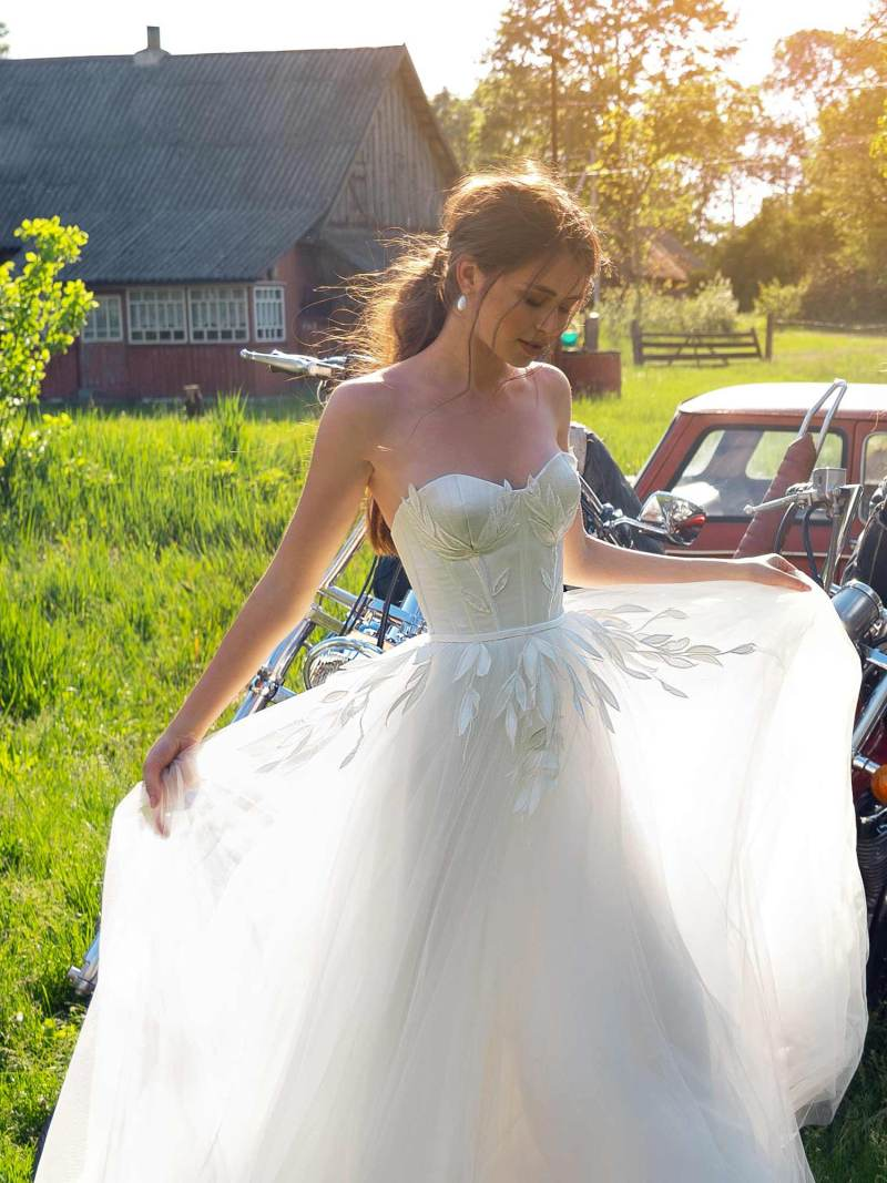 Wedding dress with bustier bodice and floral embroidery