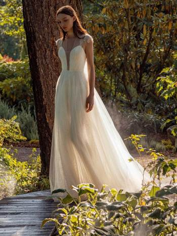 Shimmering lace A-line wedding dress with beaded shoulders