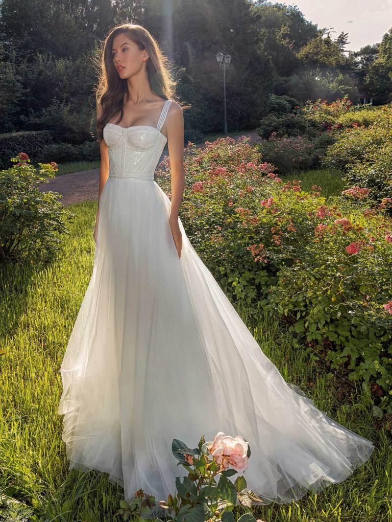 Bustier style A-line wedding dress with pearl waistline