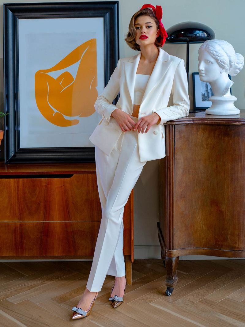 Three-piece bridal pantsuit with top and jacket
