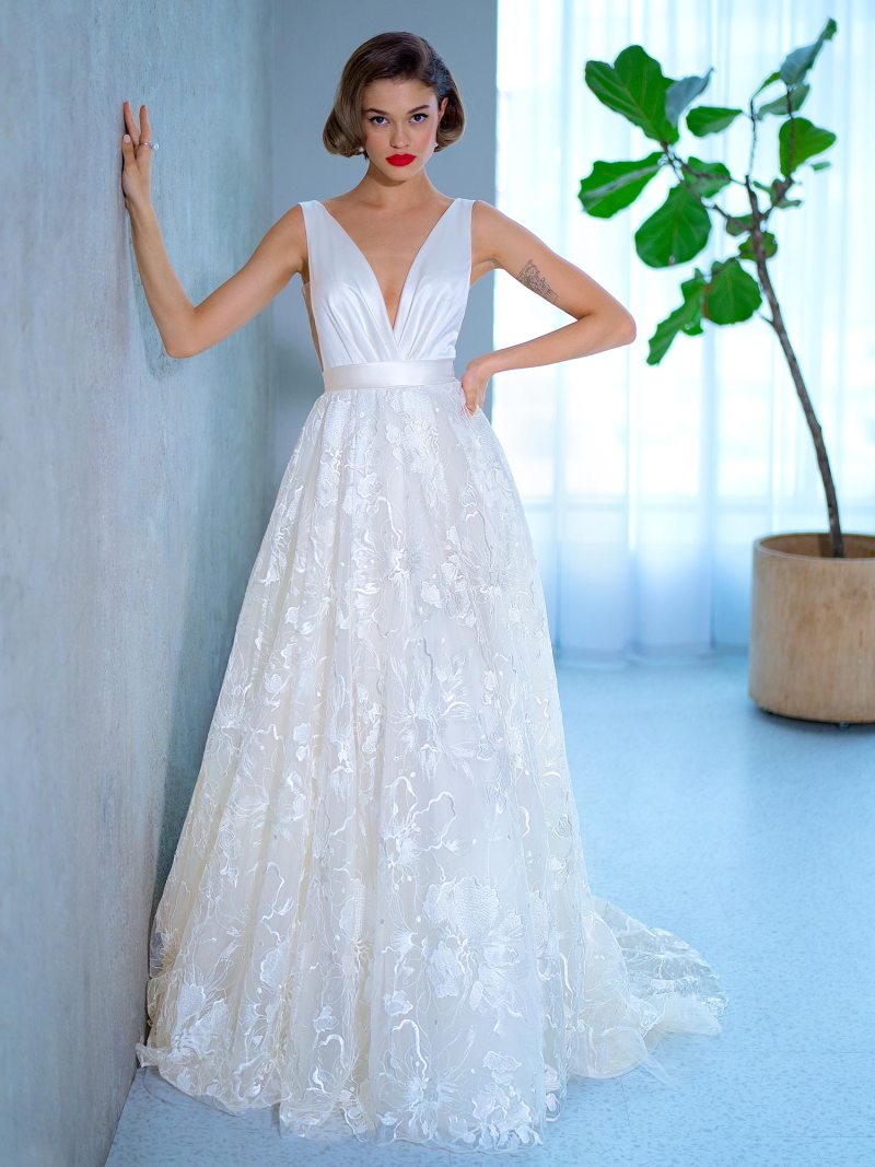 Ball gown wedding dress with floral lace skirt and atlas top