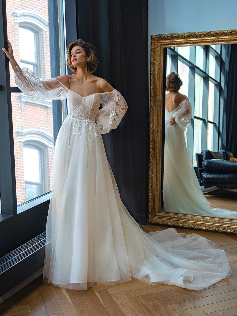 Strapless A-line wedding dress with long puffy sleeves