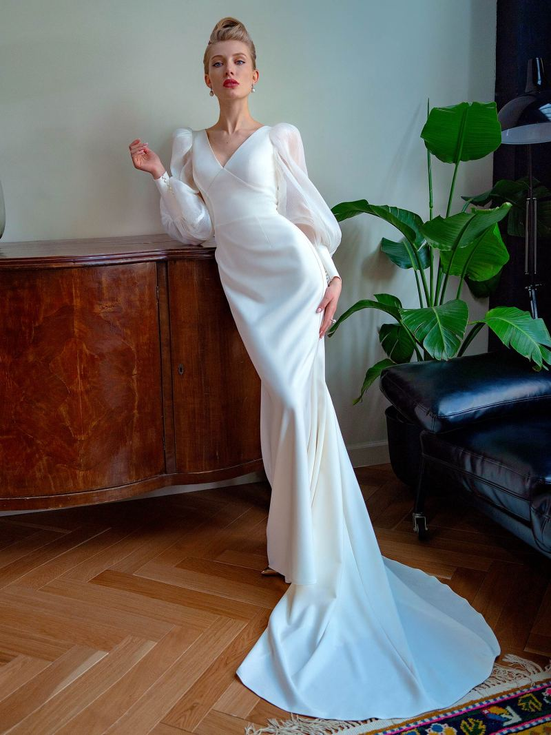 Fit and flare wedding dress with bishop sleeves