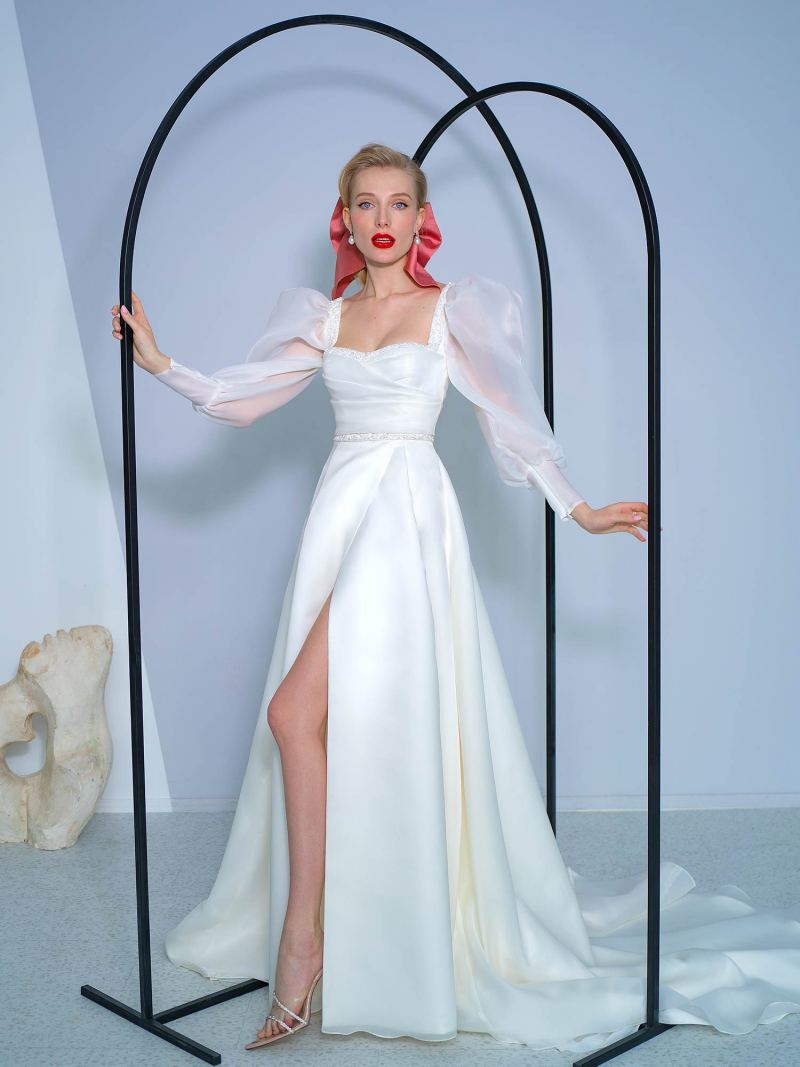 A-line wedding dress with bishop sleeves and high slit skirt