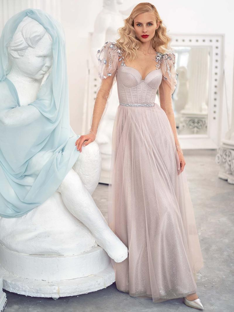 A-line evening gown with long sleeves and puffed shoulders