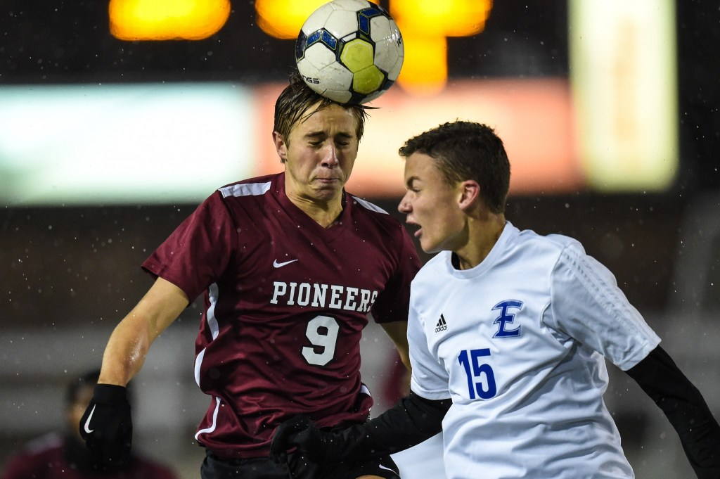 Colin Rossi (9) of Conestoga heads the ball against Billy Repko (15) of Elizabethtown in the PIAA Class 4A boys soccer championship at Hersheypark Stadium in Hershey, PA on November 19, 2016. Mark Palczewski | Special to PA Prep Live.