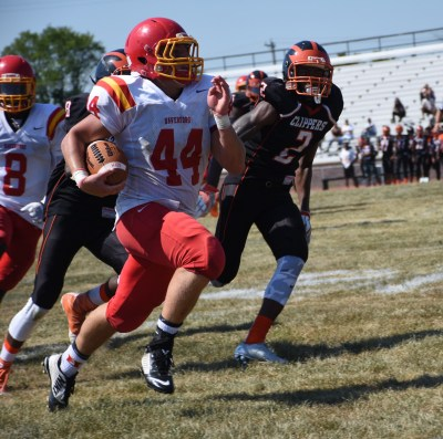 Haverford running back Mike Romanofsky, left, runs away from Braheem Bishop and the Chester defense Saturday afternoon. (Digital First Media/Anne Neborak)
