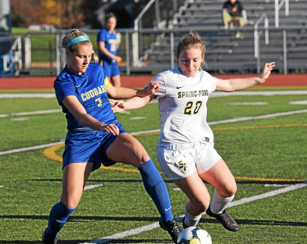 Downingtown East's Emma Steigerwald, left, and Spring-Ford's Gabby Kane battle for the ball in the first half. (Austin Hertzog - Digital First Media)