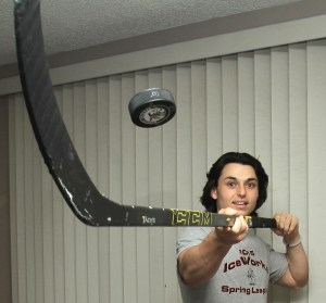 Ridley hockey player Nick Catona balances a puck in the living room of his home. (ROBERT GURECKI - DIGITAL FIRST MEDIA)