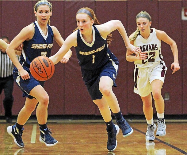 ROBERT GURECKI   -   DIGITAL FIRST MEDIA.   Springford's Sydney Wagner, center, drives the ball up court with teammate Molly Hynes, left, and Jaguars Nicole Barnes, right in tow.