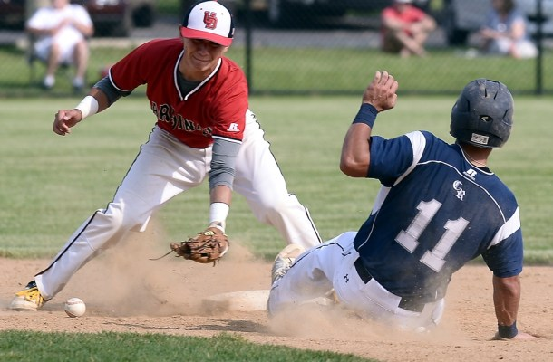 Council Rock North's Matt Hand steals second base as Upper Dublin's Tom Reilly bobbles the ball. (Bob Raines/Digital First Media)