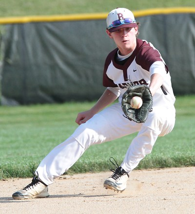 Radnor's Jack Collins backhands a tough hop in the hole at shortstop. (Robert Gurecki/Digital First Media)