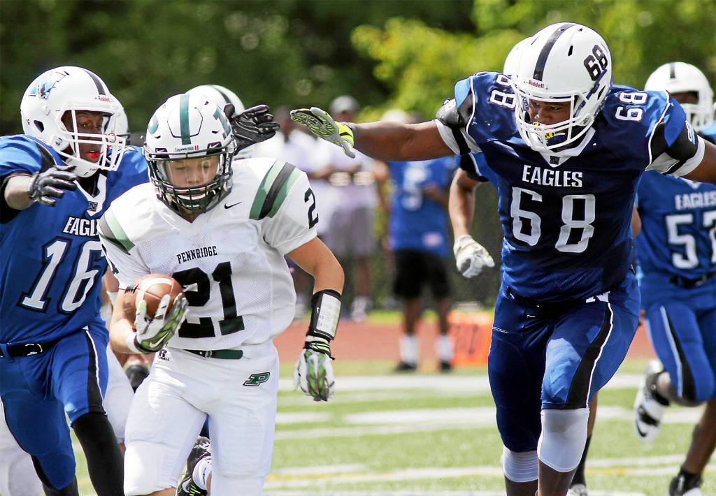Bob Raines--Digital First Media Pennridge's Andrew Nace sprints from Norristown's defense Aug. 27, 2016.